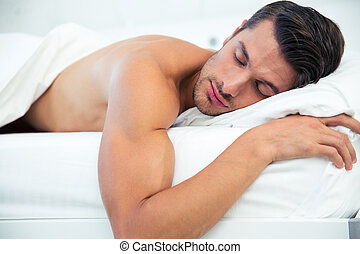 Man sleeping in the bed - Portrait of a man sleeping in the...