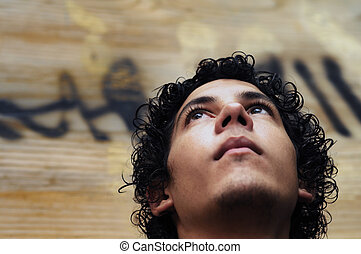 Boy Face on grunge background - Portrait of young hispanic...