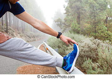 Young man exercising on the road