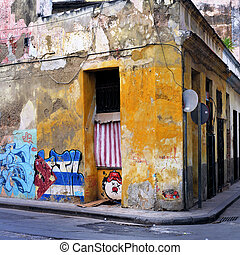 Grunge building wall in havana - Colorful building with...