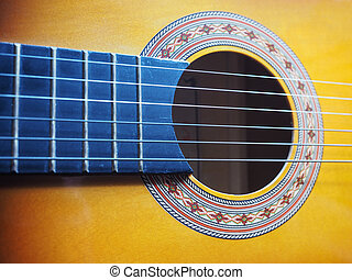 Acoustic guitar - Detail of an acoustic guitar musical...