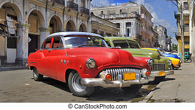 Havana street with colorful old cars in a raw - Old american...