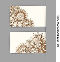 Vector template business card with the ethnic pattern of flowers