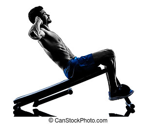 man exercising fitness crunches silhouette - one caucasian...