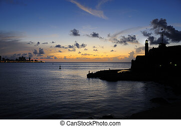 Nightfall on Havana bay - Silhouette of el Morro fortress...