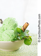 Mint ice cream in bowl - Scoop of mint ice cream in cup on...