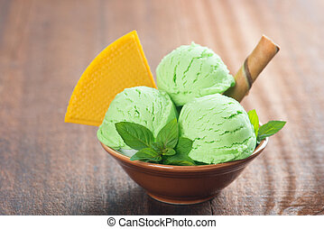 Mint ice cream - Scoop of mint ice cream in bowl on rustic...