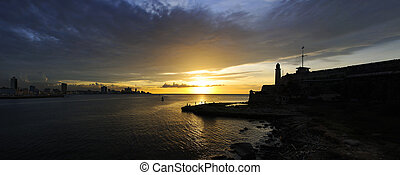 Panoramic view of fortress silhouette in Havana bay at...