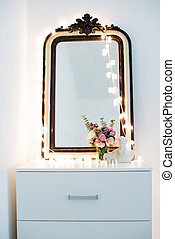 interior decoration - Vintage mirror, flowers and warm...