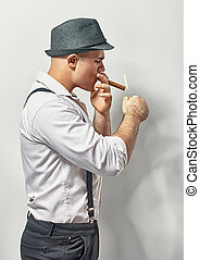 Handsome young man smoking cigar - Handsome stylish young...
