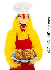 Fried Chicken Dinner - Chef in a chicken suit holding a...