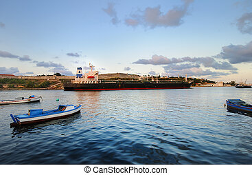 Cargo ship in havana bay, cuba - A view of large container...