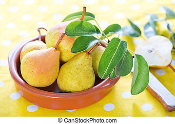 pears - fresh pears in bowl and on a table