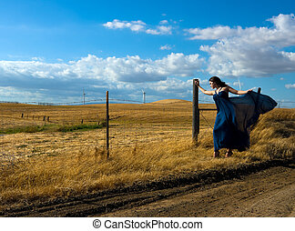 Windy Day - Girl with a designer silk dress near the wind...