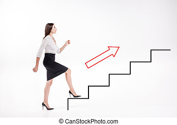 Young businesswoman walking up on stairs - Young...