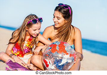 Young girls discussing next holiday destination - Close up...