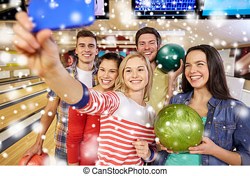 happy friends with smartphone in bowling club - people,...