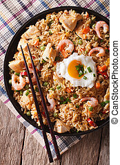 nasi goreng with chicken, shrimp and vegetables closeup...