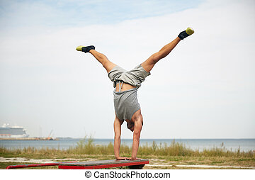 young man exercising on bench outdoors - fitness, sport,...