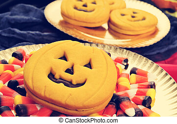 Halloween food, filtered - some trays with pumpkin-shaped...