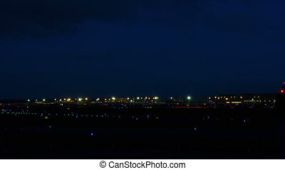 Airplane landing at night - Airbus 330 landing on runway 25L...