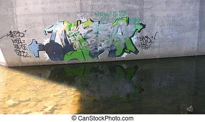 Graffiti on concrete bridge support