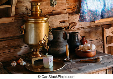 Interior of kitchen room in russian traditional wooden house...