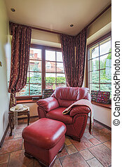 Neat armchair and pouffe - Image of neat armchair and pouffe...