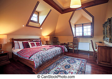 Bedroom with king size bed - Image of neat furnished bedroom...