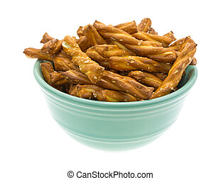 Small bowl filled with braided pretzel sticks - A small...