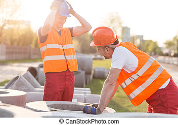 Laughing at work - Construction workers are so tired that...