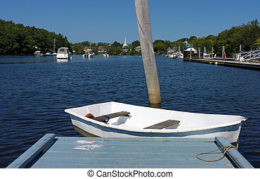 Dinghy at end of dock - A white dinghy floating at the end...