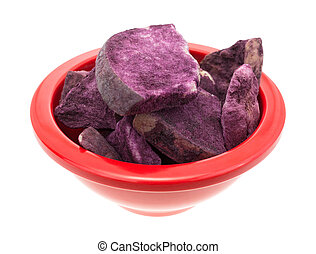 Bowl filled with freeze dried apples in Maqui berry powder -...