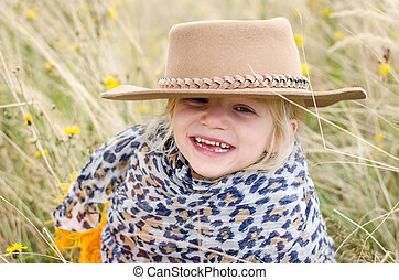 smiling girl with hat in autumn grass - beautiful smiling...
