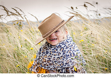 smiling girl with hat in head in autumn grass - beautiful...