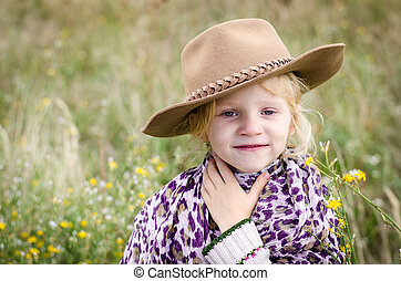 adorable girl with hat in autumn meadow - beautiful smiling...
