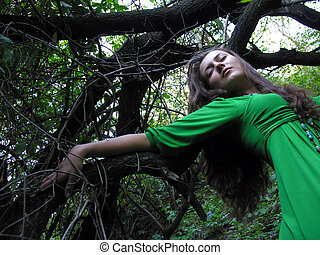 young attractive woman in the wild forest