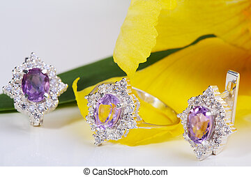 Jewelry. - Beautiful gold ring and earrings with gemstones...