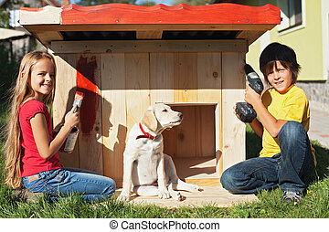 Kids preparing a shelter for their new puppy dog