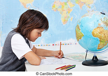 Young boy study geography