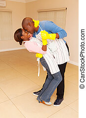 young black couple dancing - romantic young black couple...
