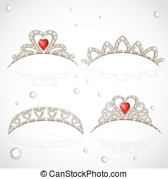 Openwork jewelry tiaras with diamonds and faceted red stones in a heart shape isolated on white background