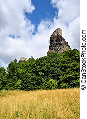 High volcanic cliff with castle towers rising high above the...