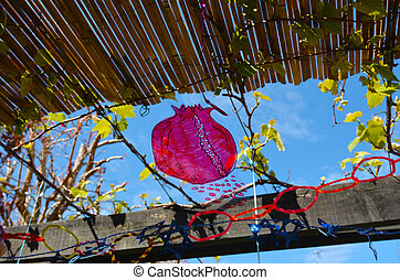 Decorations inside a Jewish family Sukkah for the Jewish...