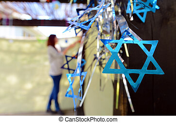Jewish woman decorating here family Sukkah for the Jewish...