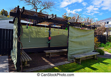 Jewish family Sukkah for the Jewish festival of Sukkot. A...