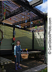 Jewish child decorating the family Sukkah - Jewish child...