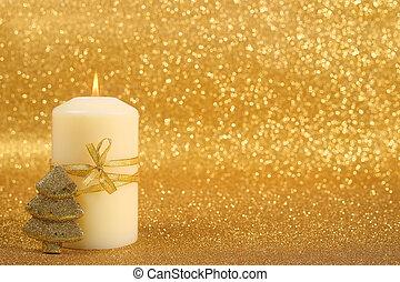 Christmas candle - Beautiful christmas candle on golden...