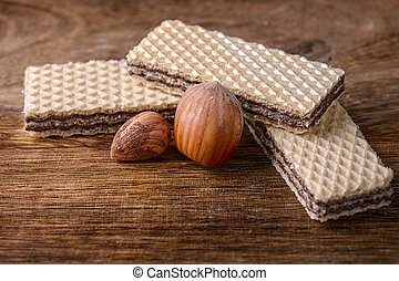 wafer and hazelnut on wood