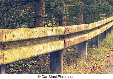 dilapidated guardrail - an old dilapidated guardrail in a...
